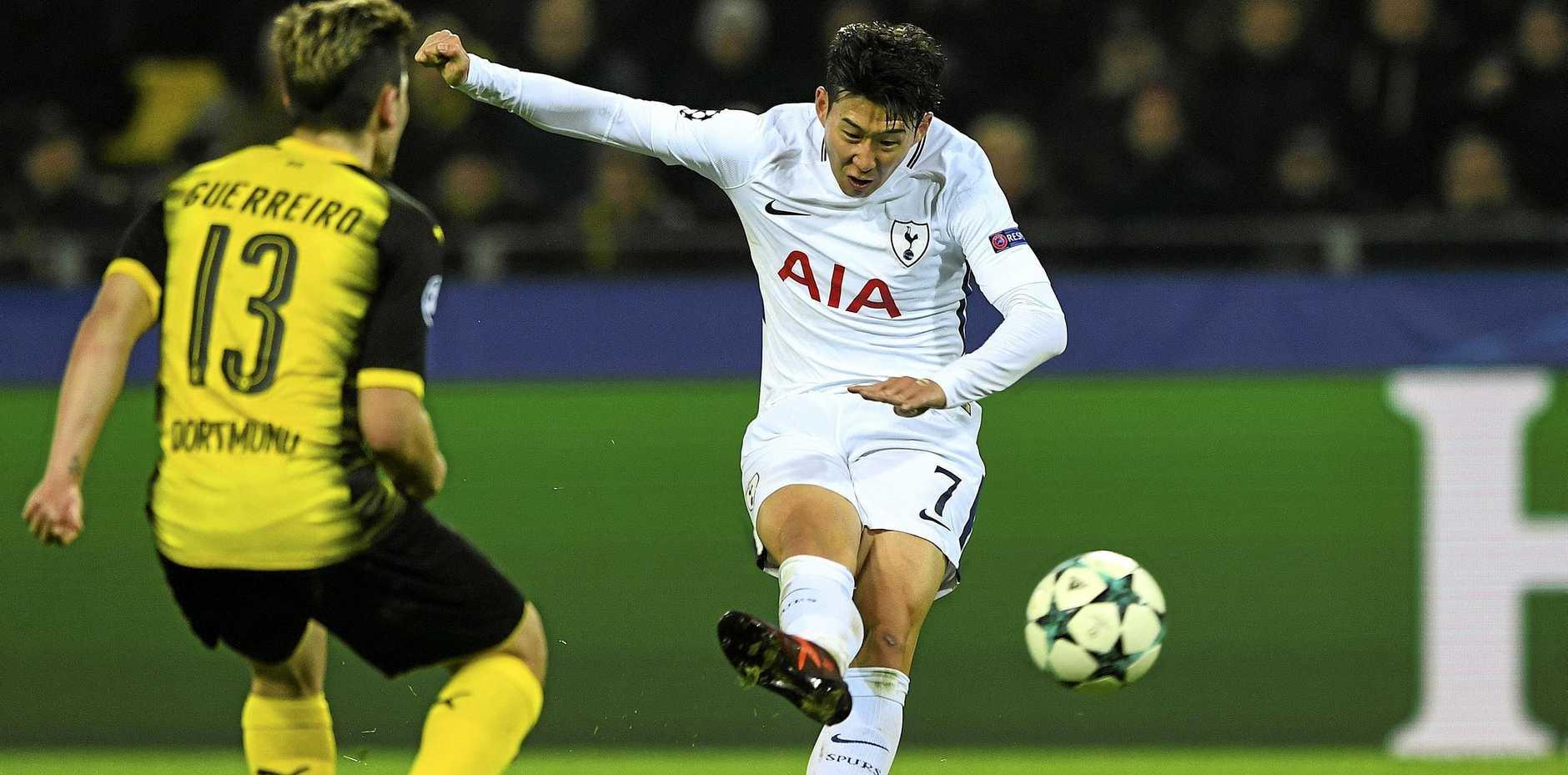 Tottenham's Heung-Min Son, right, scores a goal during the UEFA Champions League match against Borussia Dortmund.