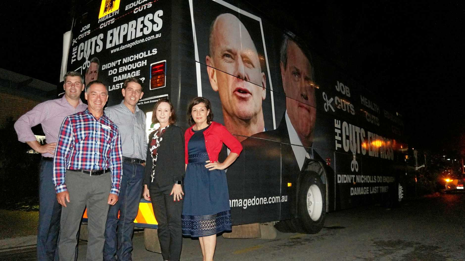 ON THE ROAD: MPs Mark Ryan, Cameron Dick, Yvette D'ath and Leeanne Enoch with Hervey Bay Labor candidate Adrian Tantari (front) and the Cuts Express in the background.
