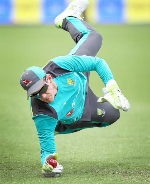Wicketkeeper Tim Paine takes a catch at an Australian Cricket team training session at the Gabba, in Brisbane, Tuesday, November 21, 2017. Australia will take on England on Thursday in the first Test of the Ashes series at the Gabba in Brisbane. (AAP Image/Jono Searle) NO ARCHIVING