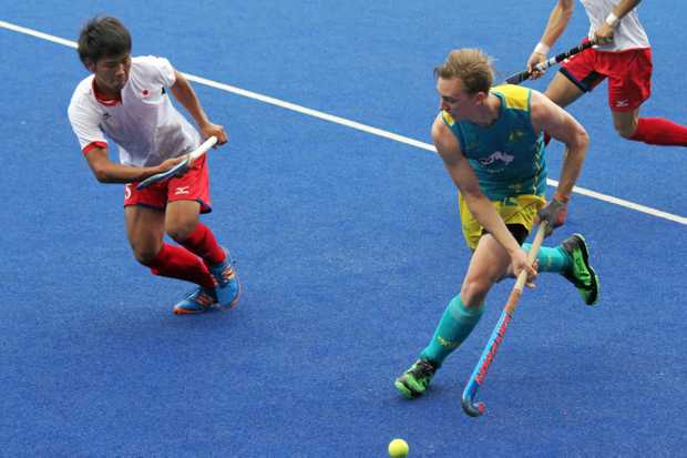 Jacob Anderson runs around his Japanese opponent looking for an opportunity during a Sultan of Johor Cup match.
