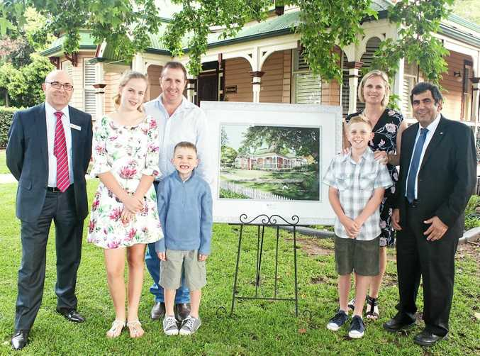 COVER PICK: Announcing the 2018 calendar are (from left) Heritage Bank CEO Peter Lock, owners Jayne and Ciaran Gentry with kids Gabby, Ben and Zander, and Heritage Bank chairman Kerry Betros.
