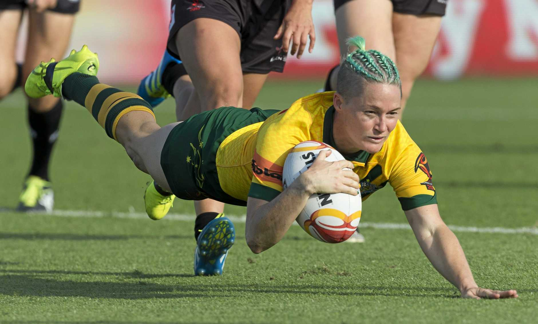 DOMINANT: Chelsea Baker of Australia scores her second try during the Women's Rugby League World Cup match between Australia and Canada.