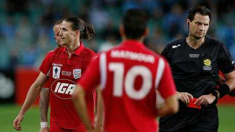 Adelaide's Michael Marrone is shown a red card and sent off during the FFA Cup Final against Sydney FC. Picture: Zak Kaczmarek/Getty Images