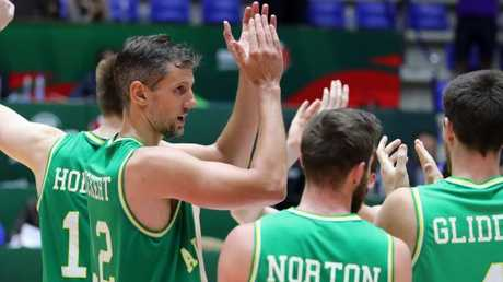 Australia's players celebrate scoring against New Zealand's team during their 2017 FIBA Asia Cup semi-final basketball match, in the Lebanese town of Zouk Mikael north of Beirut on August 19, 2017.