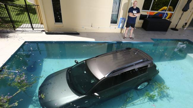 Four-wheel dive: The car in the Sammut family's pool at O'Brien Court, Arundel. Picture: Glenn Hampson
