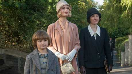 L-R: Will Tilston as Christopher Robin, Margot Robbie as Daphne Milne and Kelly Macdonald as Olive in a scene from film Goodbye Christopher Robin