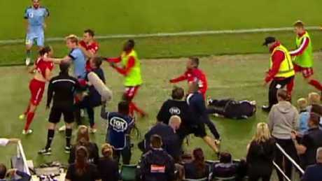 A still of the melee that disrupted play after the ball boy went to ground in the FFA Cup final. Picture: FOXSPORTS