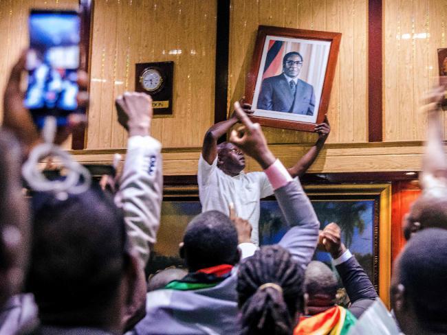 In 2017, crowds celebrate the resignation of Zimbabwean President Robert Mugabe. Picture: AFP/Jekesai Njikizana