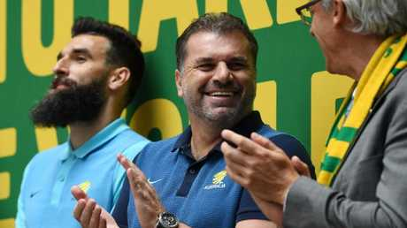 Ange Postecoglou (middle) with Mile Jedinak and David Gallop in Martin Place after the team qualified for the 2018 World Cup.