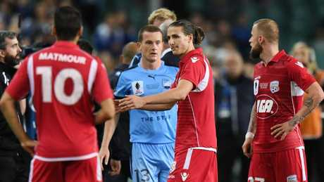 Adelaide United's Michael Marrone leaves the pitch after being sent off following the ball-boy incident at Allianz Stadium. Picture: AAP Image/David Moir