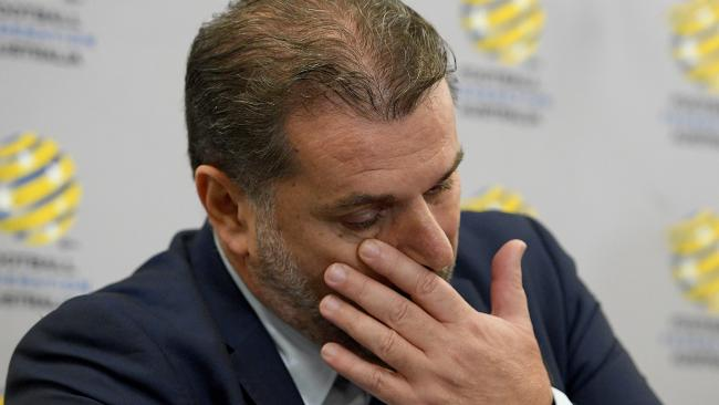 An emotional Ange Postecoglou wipes away tears at the media conference on Tuesday morning.