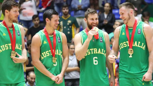 Australian players celebrate their Gold Medal after defeating Iran during their 2017 FIBA Asia Cup final basketball match, in the Lebanese town of Zouk Mikael north of Beirut on August 20, 2017