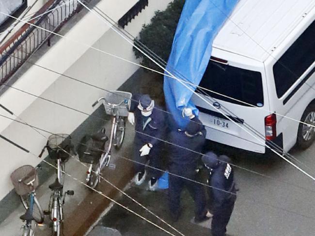 Police investigators outside the apartment. Picture: AP