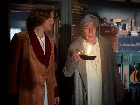 Dan Stevens and Christopher Plummer in a scene from the movie The Man Who Invented Christmas.