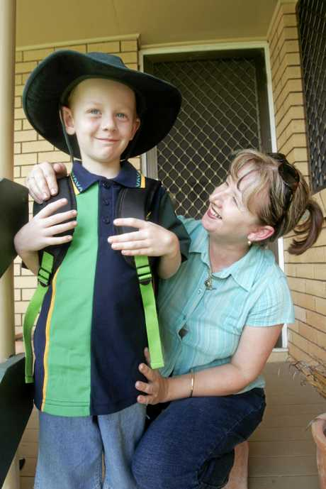 THEN: Logan Bischoff, with mum, Keryn, pictured at five-years-old (in 2005) on his first day of prep at Golden Beach State School.