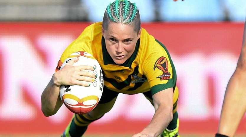 SUPERWOMAN: Chelsea Baker flies for a try in Wednesday's Jillaroos' 88-0 demolition against Canada. The two teams meet again in Sunday's semi-final.