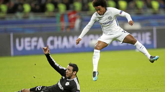Willian (right) reacts after scoring his second goal in Chelsea's 4-0 Champions League win over Qarabag in Azerbaijan.