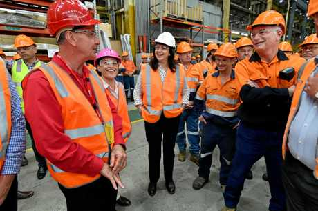 Queensland Premier Annastacia Palaszczuk (centre) and Deputy Premier Jackie Trad (2nd from left) is seen talking with workers at the Downer EDI Rail manufacturing plant in Maryborough during the Queensland Election campaign on Thursday, November 9, 2017. Premier Palaszczuk announced if re-elected her government would make a $150 million commitment to protect and create new jobs in the manufacturing sector. (AAP Image / Darren England) NO ARCHIVING