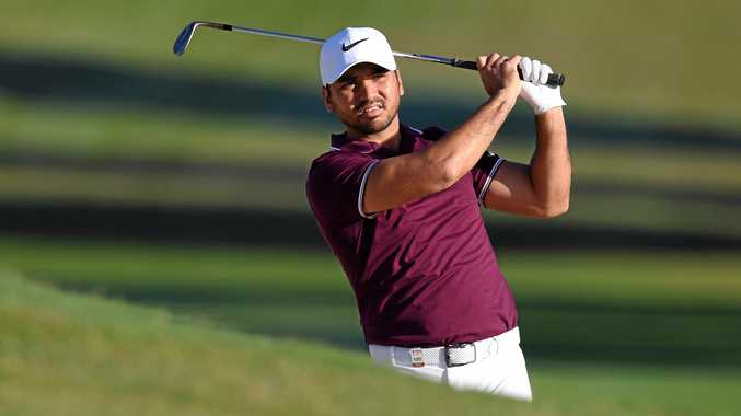 Jason Day plays an iron shot on day one of the Australian Open Golf Championship.