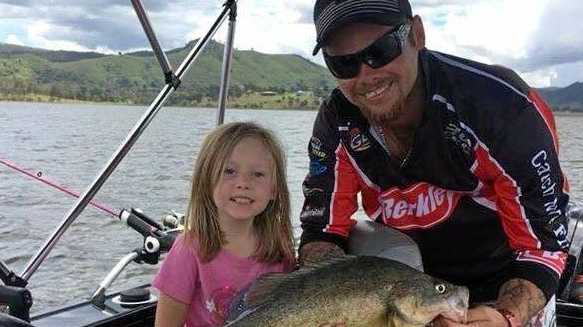 Dan and Summer Lotz happy with the nice yellowbelly they reeled in from Somerset Dam