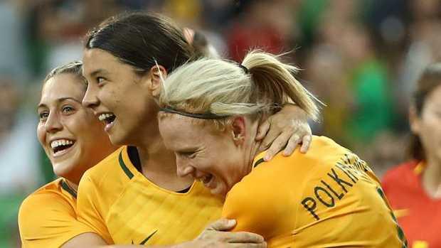 Matildas star Sam Kerr (centre) celebrates scoring against China on Wednesday night.