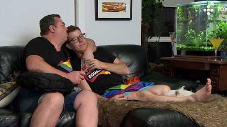Wayne and Tom have a cuddle on the couch.