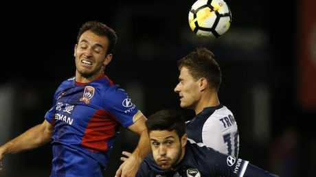 Newcastle's Ben Kantarovski (left) and Melbourne Victory's James Troisi (right), compete for the ball on Thursday night.