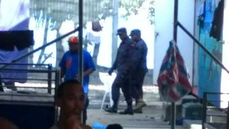 The PNG army has been sent in to clear 400 men from the Manus Island detention centre. Source: Supplied