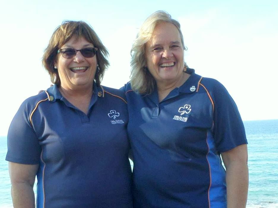 Gold Coast Girl Guides region manager Joy Ord (left) welcomes new leader Carol Stubbs to an organisation that's intent on having fun.