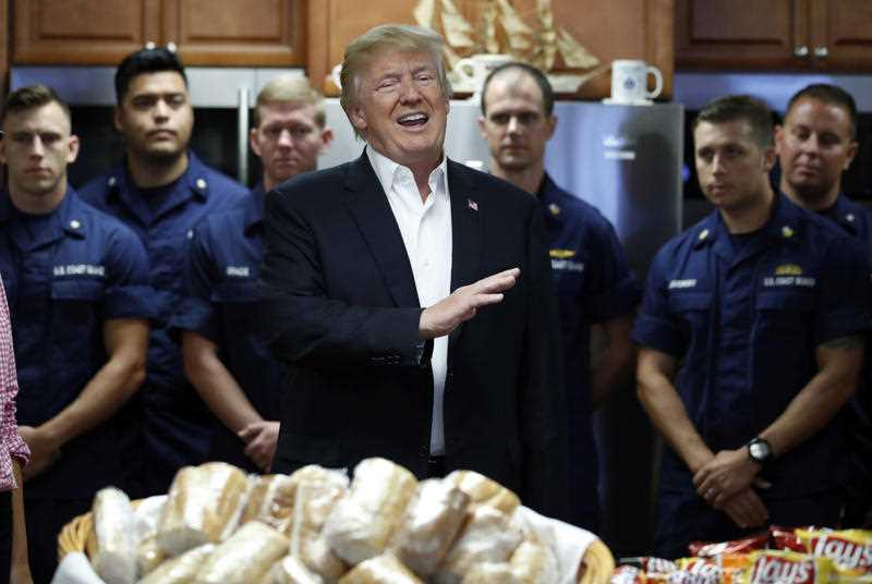 President Donald Trump speaks to members of the U.S. Coast Guard at the Lake Worth Inlet Station, on Thanksgiving. AP Photo/Alex Brandon.