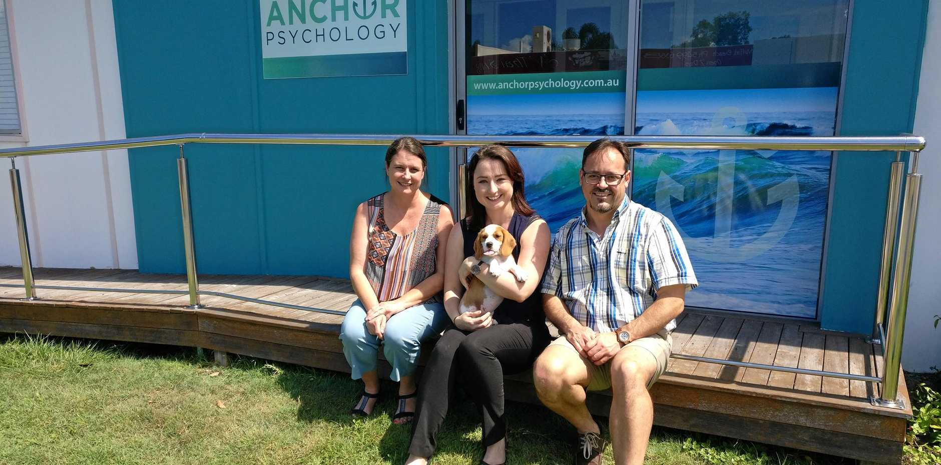 PROVIDING THERAPY: Fudge (centre) with Dr Zach De Beer (right) and two of his staff members.
