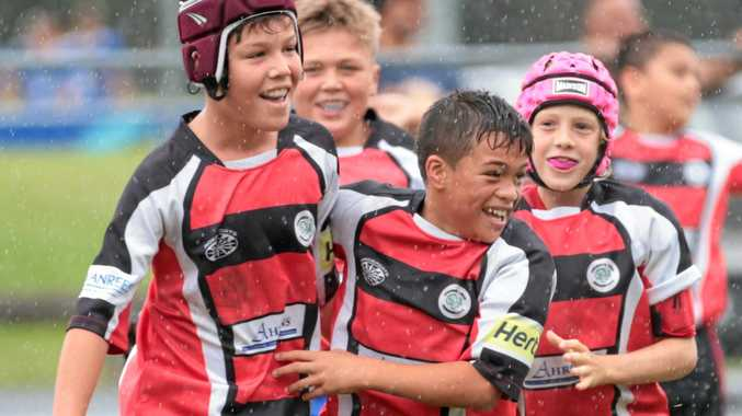 BIG WIN: Coolangatta Tweed Barbarians U10 player Calais Hellett-Wharewaka (winner of the referees' player with the most potential award, centre) celebrates his side's rugby sevens win with fellow teammates.