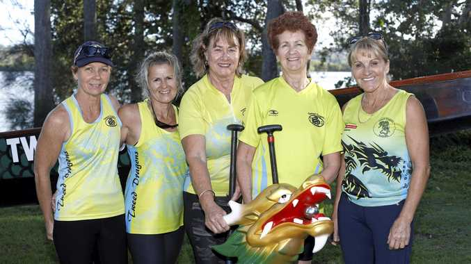 PADDLES AT THE READY: Kathy Afflick, Colleen Drysdale, Margaret Puttand, Claire Irving and Julie Castles of Tweed Dragons are keen for the Kids in Need fundraiser at Jack Evans Boat Harbour this weekend.