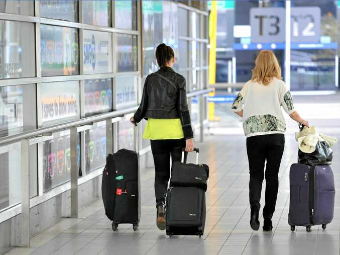 Australians rack up an average of $2000 on their credit cards while on holiday.