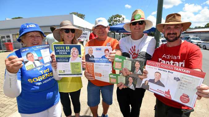 MAKE YOUR CHOICE volunteers from left, Norma Hannant (LNP), Toni-Lee Dale (independent), Greg McHugh (One Nation), James Dasecke (Greens) and Nathan Scattergood (Labor) at Hervey Bay's pre-poll on Dayman St.