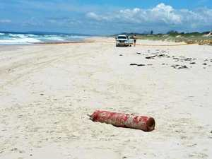 Exclusion zone set up after gas cylinder washes up on beach