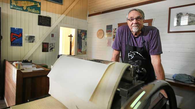 ART: Peter Schardin prepares the printmaking press ahead of the CPM open day.
