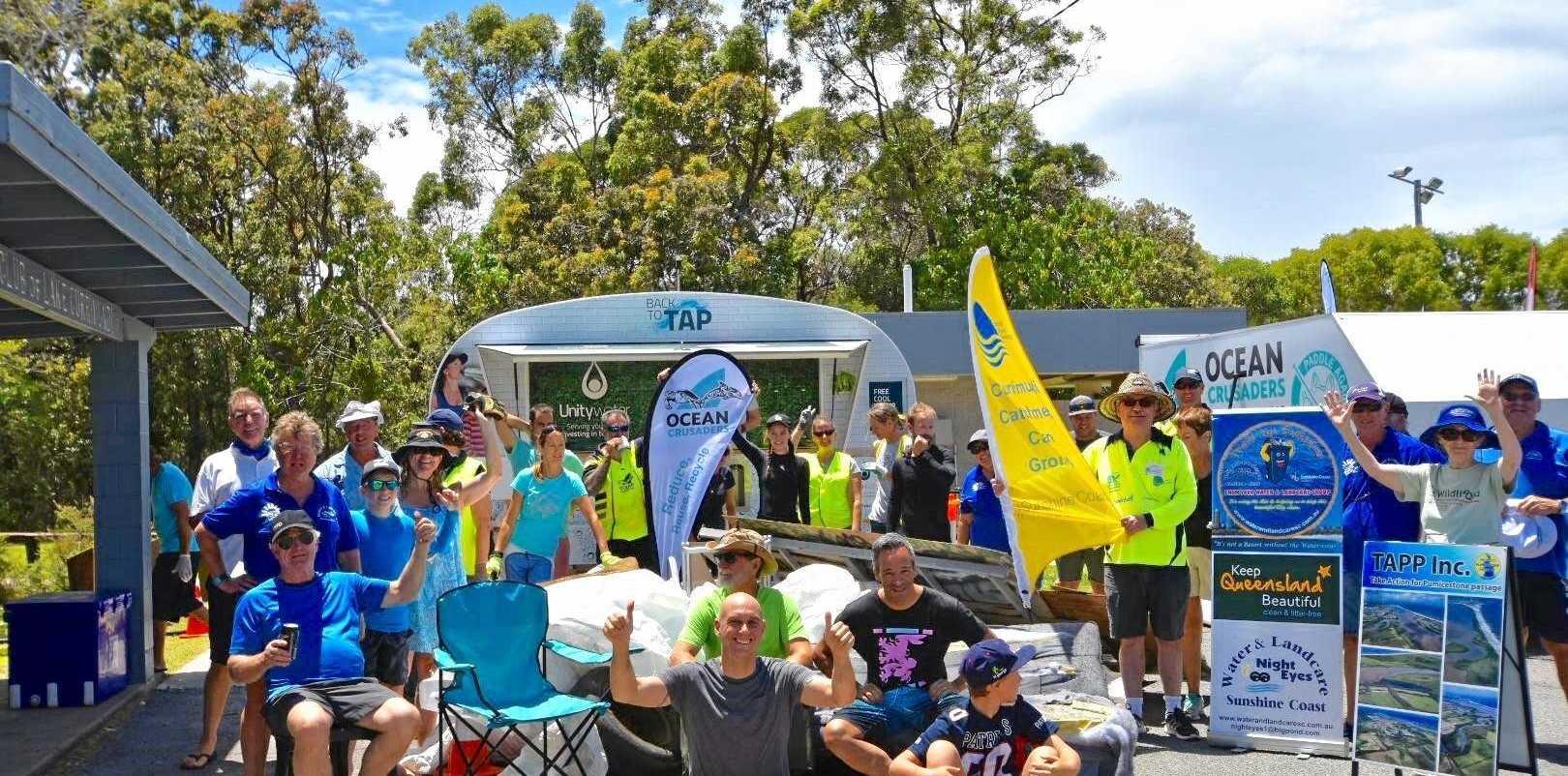 Volunteers celebrate the success of their clean-up around Currimundi Lake.