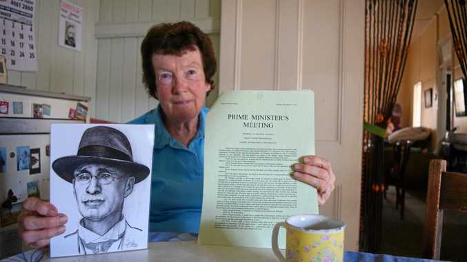 Mary Devereux with a portrait of her grandfather, Frederick Charles Meredith Burne, the police magistrate who presided over the case of egg-thrower Patrick Brosnan and the court transcript from the day.