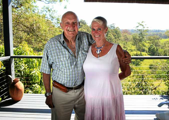BACK HOME: This year's Tweed Australia Day ambassador Iain Finlay with wife Trish Clark on the deck of their North Tumbulgum home earlier this year. They are now in Laos overseeing the building of a school dormitory.