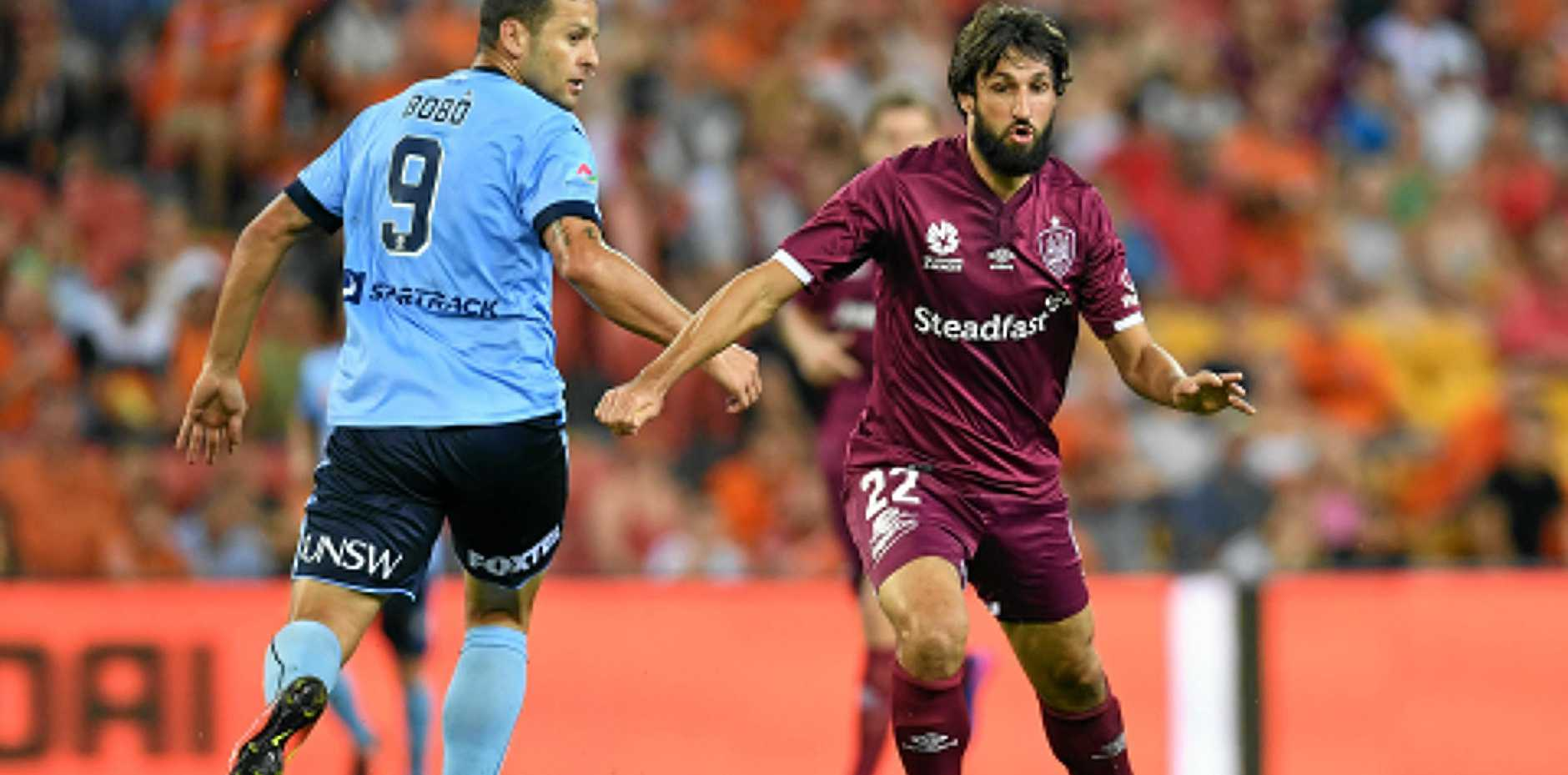 FOCUS: Roar's Thomas Broich (right) gets past Sydney FC's Bobo. Their coaches are concetrating on their club sides and not the Socceroos job.