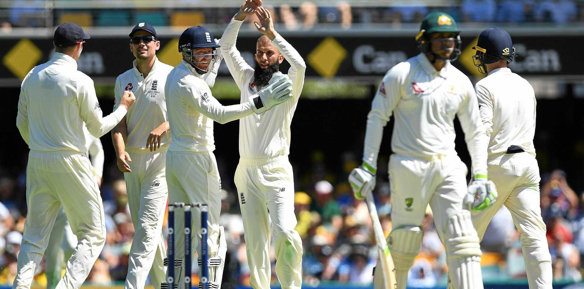 GOT HIM: Usman Khawaja is out again to off-spin, leg before to Moeen Ali (centre).