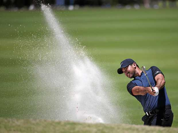 Australia's Jason Day hits a shot from a fairway bunker during the second round of the Australian Open Golf tournament in Sydney