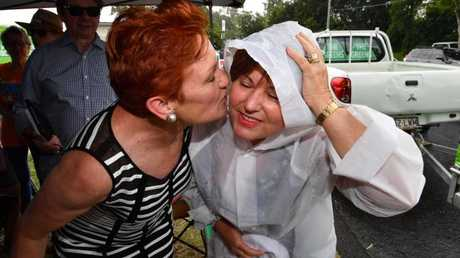 One Nation leader Senator Pauline Hanson and ALP member for Bundamba, Jo-Ann Miller cosy up. Picture: AAP/Darren England