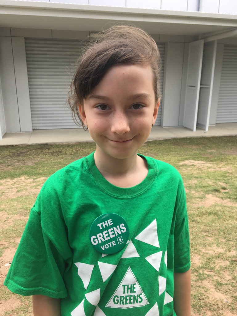 Greens supporter Lillian Stewart, 9, campaigns on election day in Hervey Bay.