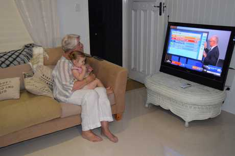 Margaret Strelow watches election results with her granddaughter.