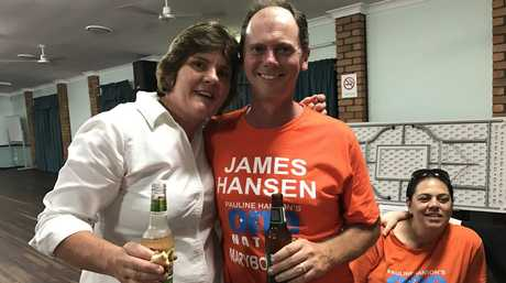 Maryborough's One Nation candidate James Hansen with his wife at a private election function watching results come in.