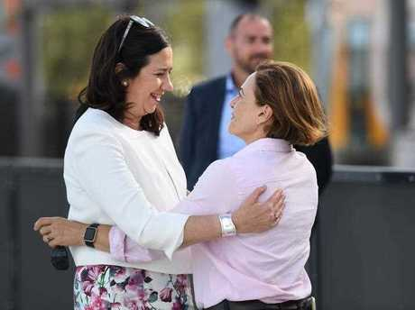 Queensland Premier Annastacia Palaszczuk (left) and her deputy Jackie Trad hug on arrival at the light rail platform on the Gold Coast, Friday, November 24, 2017. Ms Palaszczuk is on the campaign trail ahead of tomorrow's state election.