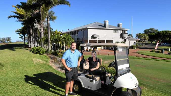 Callen Harwood and Rhiannon Pashley outside the Coral Coast Golf Club building.