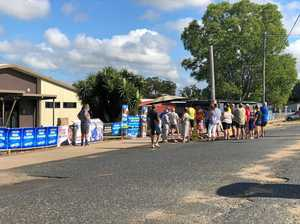 Voters lined up before polling booths opened